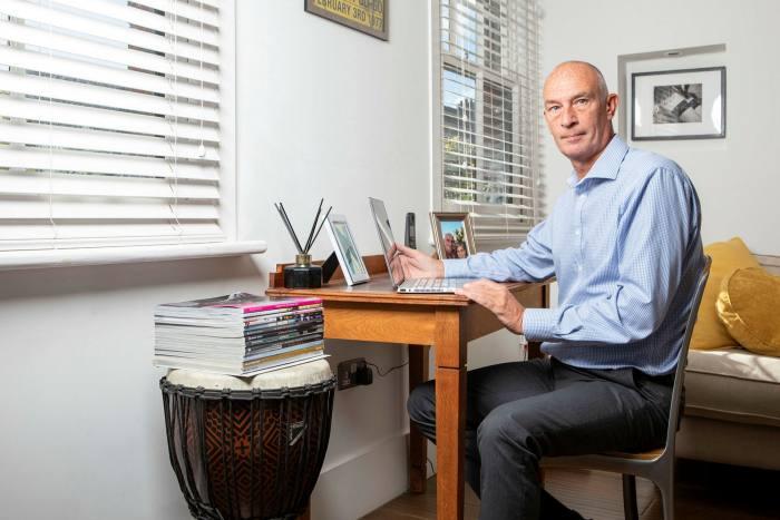 Recruiter Jason Bandy sits at his desk at home