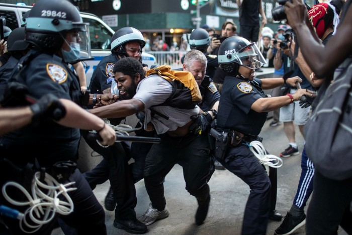 Police detain protesters during a rally over the death of George Floyd in New York. President Donald Trump said governors should 'dominate' protesters, as he agitated to send the military on to America's streets