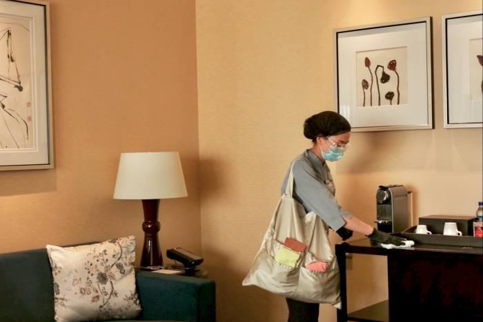 Cleaners at the Four Seasons hotel in Beijing carry colour-coded cloths to clean different parts of the guestroom