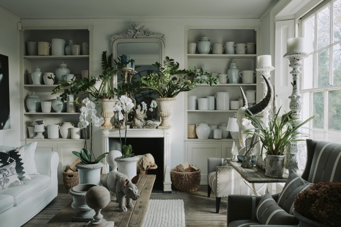 Thefront hall, with Waller's collection of antique French stoneware pots