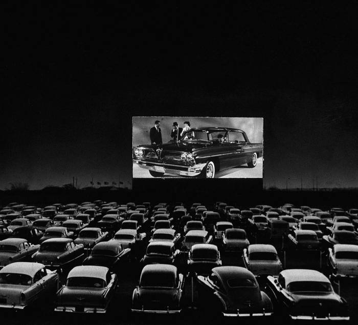 Cars fill a 1950s drive-in