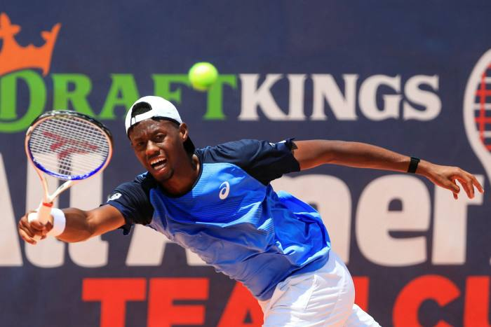 Christopher Eubanks returns the ball on the final day of the DraftKings All-American Team Cup in July. Just a few months after closing, DraftKings has soared on the hype around sports betting