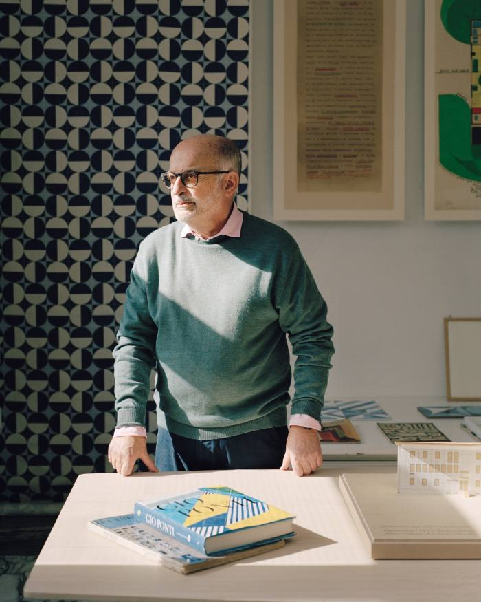 Ponti's grandson Salvatore Licitra, who manages the Gio Ponti Archives, with (in background) the Eclipse printed fabric that Ponti designed for Manifattura JSA in 1957