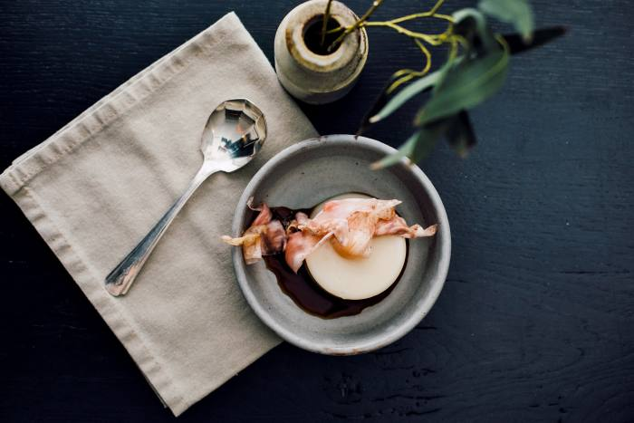 Spent-oat panna cotta with black vinegar and pickled magnolia