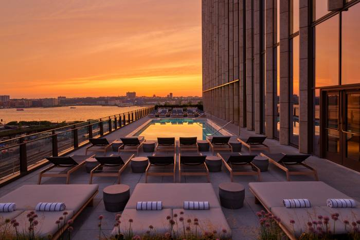 The outdoor pool boasts a sun deck and views over the Hudson River