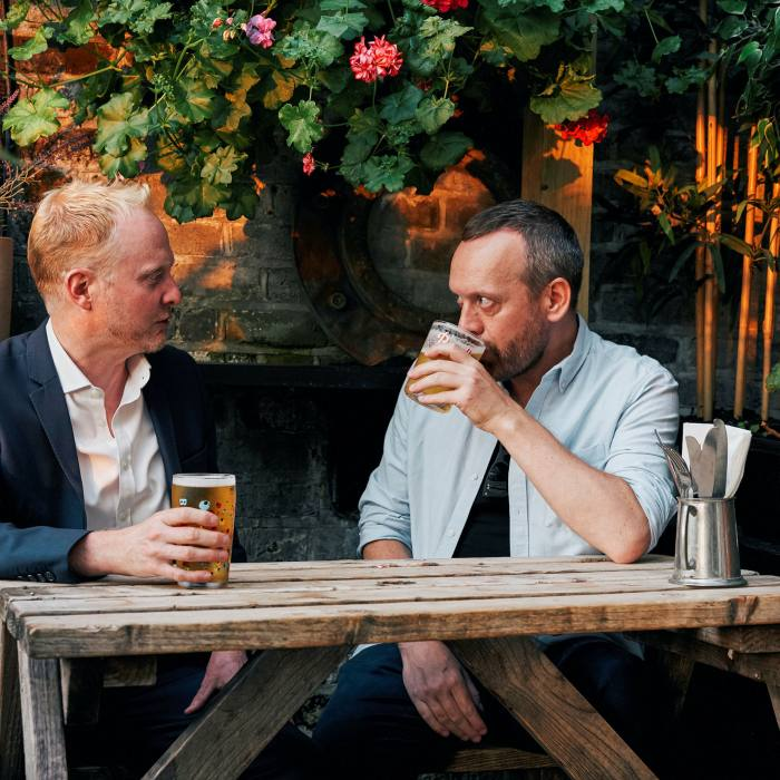 'The pub we most look forward to revisiting': the authors enjoy a pint at The Mayfair
