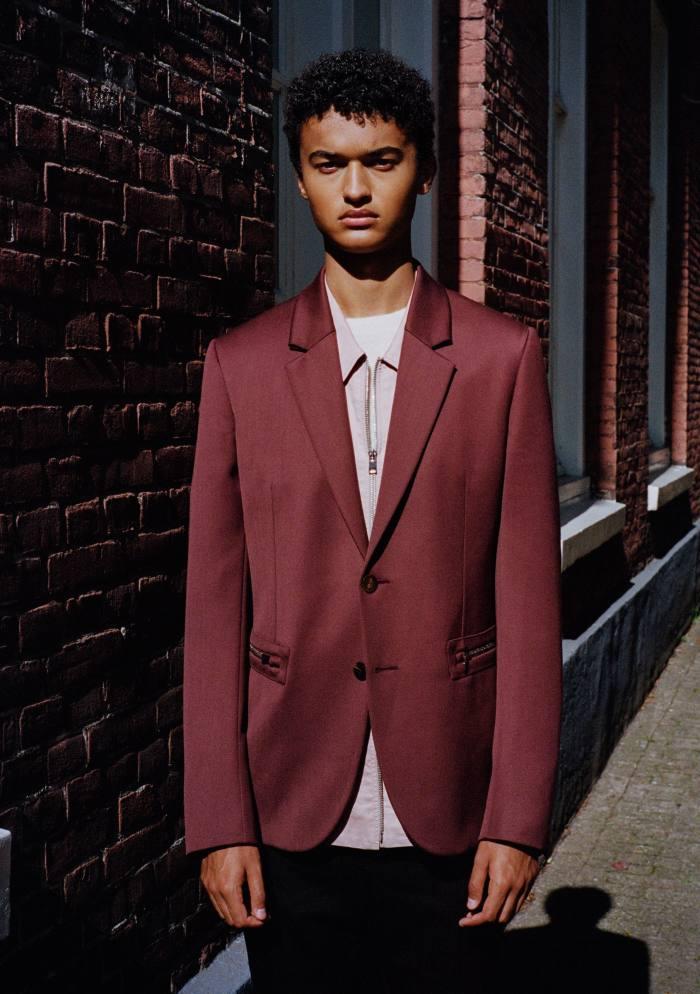 Julian Stordiau is a high-school student and keen kickboxer. Ermenegildo Zegna XXX wool gabardine jacket, £2,300, and cotton shirt, £680. Gucci wool jumper, £520. Bottega Veneta cotton trousers, £655