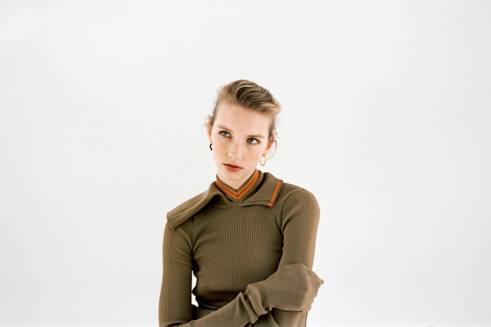 Y/Project cotton jumper, £388. Charlotte Chesnais vermeil and enamel Wave earring (on left ear), £360 for a pair. Other earring, model's own
