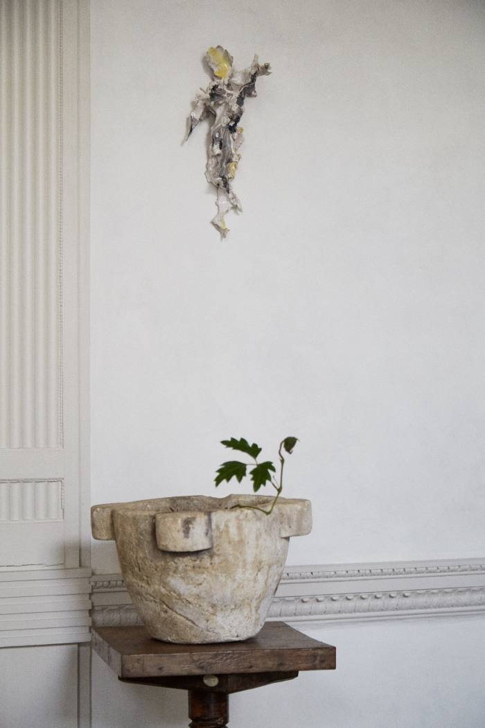 Her antique stone mortar