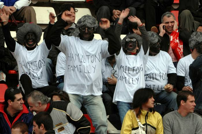 A group of F1 fans attracted a storm of controversy in 2008 by wearing black face paint and wigs at the Spanish Grand Prix in Barcelona