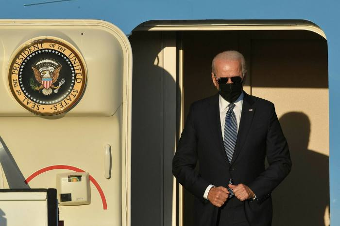Joe Biden disembarks from Air Force One in Belgium on Sunday for a Nato summit