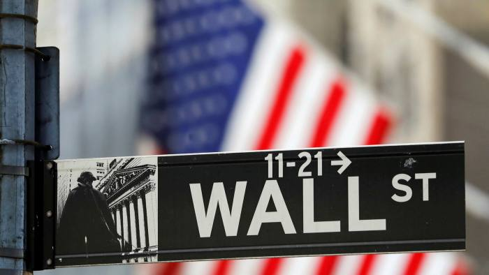 A street sign for Wall Street outside the New York Stock Exchange