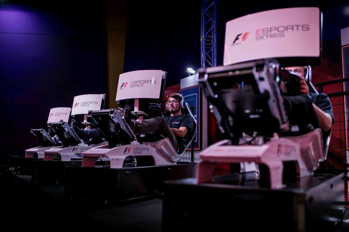 Participants compete in the 2017 F1 Esports Pro Series at the GFinity Arena in London