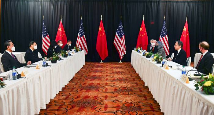 US Secretary of state Antony Blinken (2nd R) and Jake Sullivan (R) face Yang Jiechi (2nd L), director of the Central Foreign Affairs Commission Office, and Wang Yi (L), China's foreign minister, at US-China talks in Anchorage, Alaska, in March