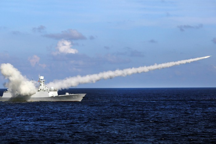 In this 2016 photo, Chinese missile frigate Yuncheng launches an anti-ship missile during a military exercise near south China's Hainan Island and Paracel Islands
