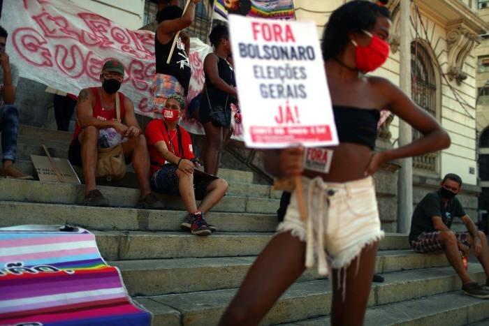 A demonstrator holds a placard reading 'Bolsonaro out, general elections now!' in Rio de Janeiro, as concern rises over the number of military officers in Brazil's administration