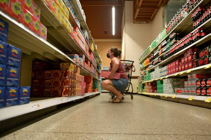 Jen Valencia works part time for Instacart at Wegman's last  August in Woodbridge, New Jersey. The pandemic prompted a spike in on-demand grocery shopping and delivery