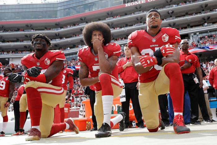 San Francisco 49ers' quarterback Colin Kaepernick and team mates take the knee during the national anthem played before an NFL football game against the Dallas Cowboys in 2016