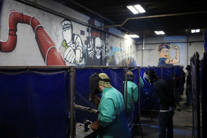 Students practice welding at a school in Louisville, Kentucky. Biden'sBuild Back Better plancould cost more than $3tn in areas ranging from infrastructure and climate change, to childcare, healthcare and education