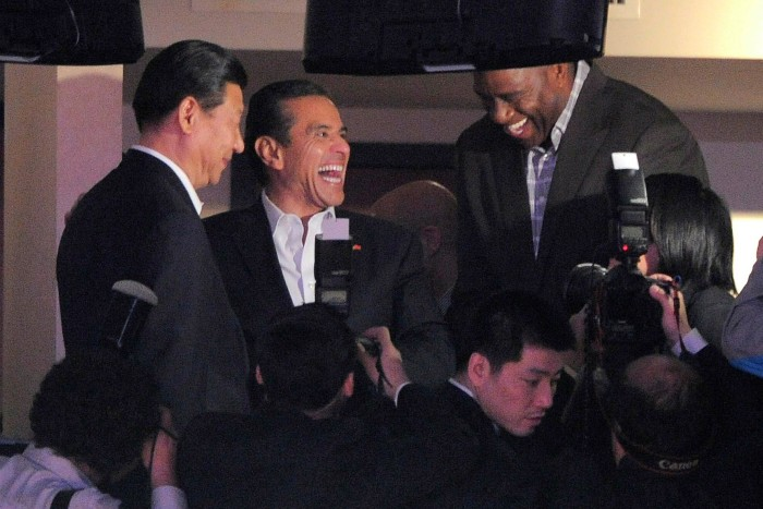 Xi Jinping meets Magic Johnson with then Los Angeles Mayor Antonio Villaraigosa at a Lakers game in February 2012