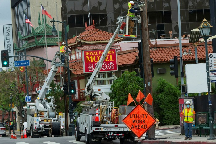 AT&T workers install fibre optic lines for a mobile phone tower station in LA's Chinatown neighbourhood last year