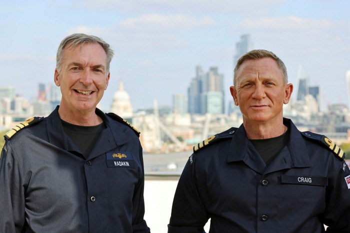 Daniel Craig, right, receives the honorary rank of Commander of the Royal Navy from the Chief of the Royal Navy, First Sea Lord Admiral Sir Tony Radakin