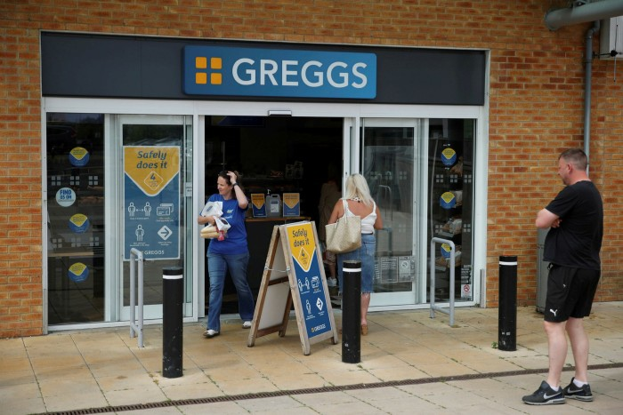 Customers queue outside a Greggs in Newcastle, England