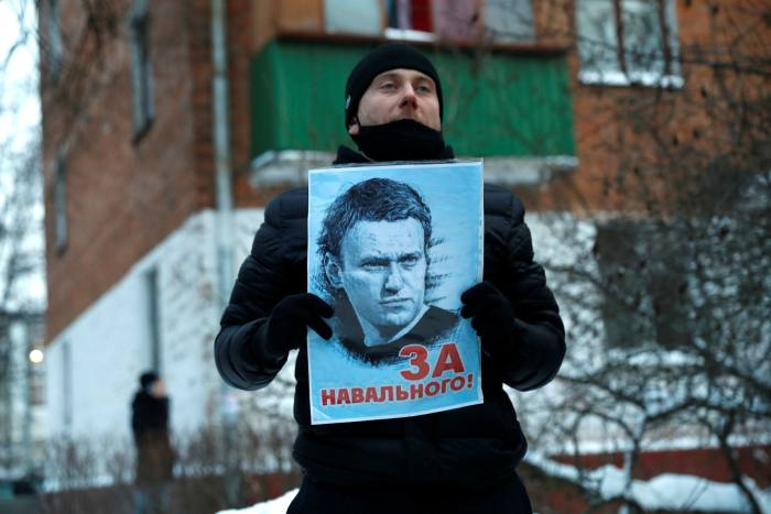 A supporter of Russian opposition leader Alexei Navalny