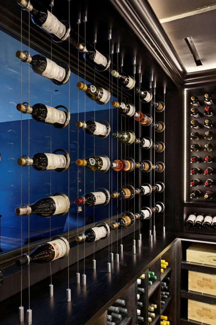 780-bottle capacity with spiral cellars with a burnt-walnut, halo light, climate-controlled bespoke wine room