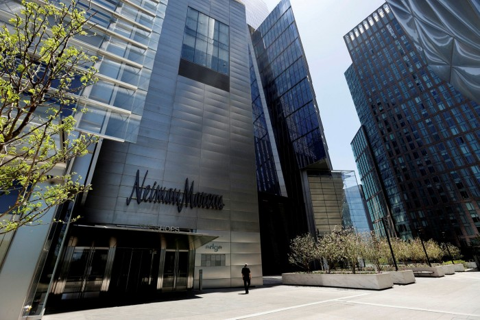 A man walks past the Neiman Marcus store, which has filed for bankruptcy, at Hudson Yards