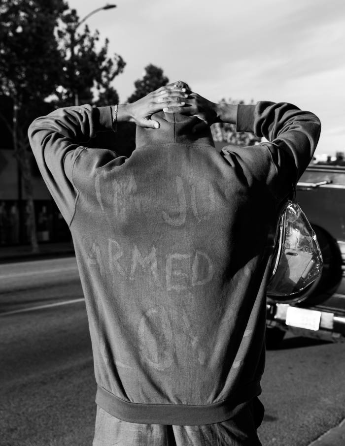Fairfax, LosAngeles, May 30. A protester's sweater reads 'I'm Just Armed with Love'