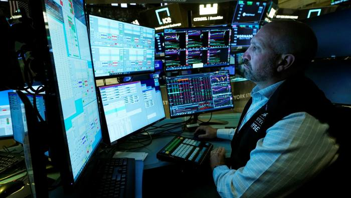 Specialist James Denaro works at his post on the floor of the New York Stock Exchange
