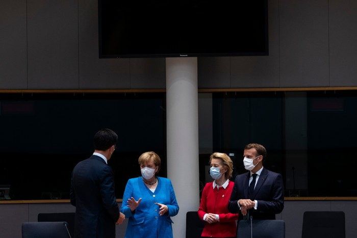 """(From left) Netherlands prime minister Mark Rutte; German chancellor Angela Merkel; president of the European Commission Ursula von der Leyen; and France's President Emmanuel Macron at an EU summit on July 18. """"We were facing the risk of a crisis that could blow up the European Union,"""" says Johannes Hahn, the EU's budget commissioner"""