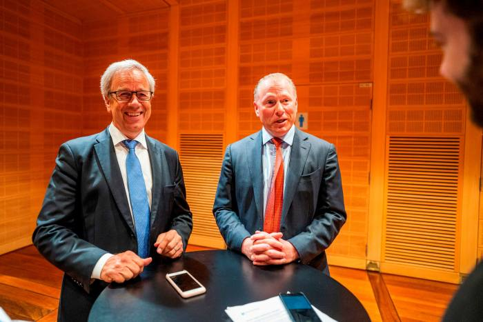 Norway's central bank governor Oystein Olsen with Nicolai Tangen. The bank initially allowed the head of the Norwegian oil fund to keep his controlling stake in AKO Capital, but some politicians decried the potential conflicts of interest