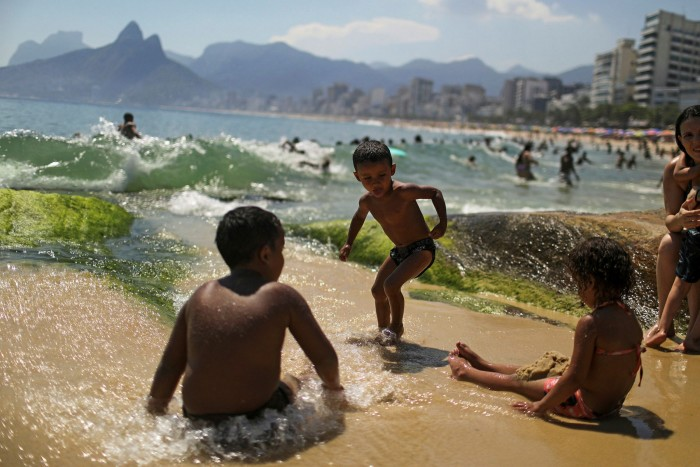 Children play on Arpoador beach, Rio, during the coronavirus outbreak. With one of the more virulent variants of the virus spreading rapidly in Brazil, many countries have in effect closed off travel to the Latin American nation
