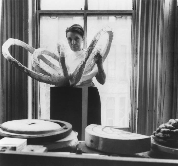 The inspiration: Louise Bourgeois in her studio with her sculpture Life Flower I (in progress), c1960