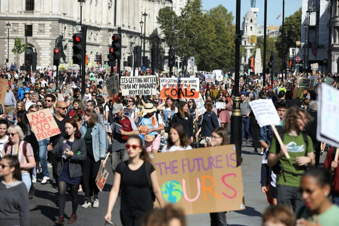 Anti-climate change protesters in London. Hit disproportionately by an economic shutdown that disrupted jobs more than assets, young adults are mobilising around such issues