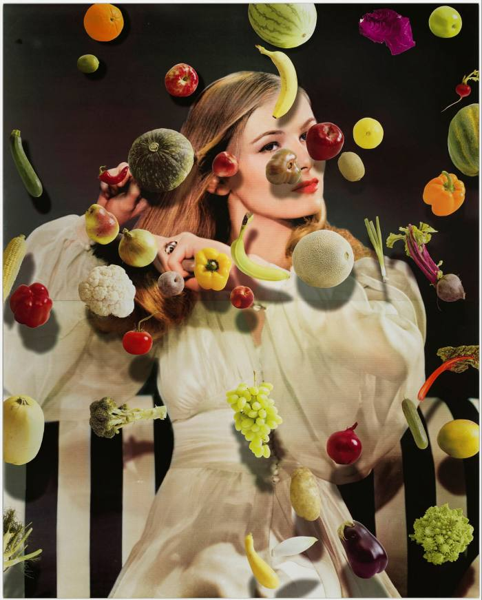 A photo of a woman under various fruits