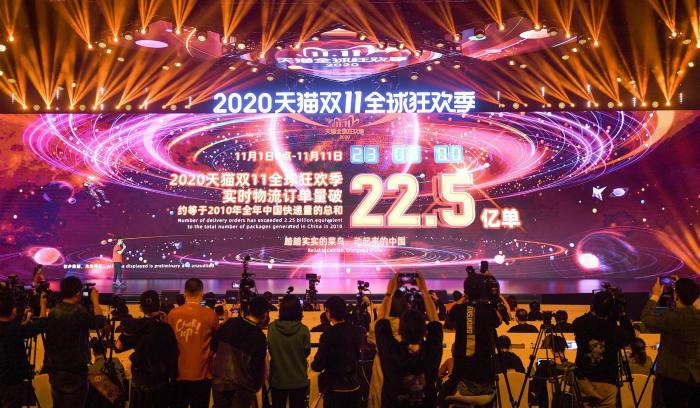A screen at a shopping event in Hangzhou shows Alibaba's number of delivery orders last year. The company's shares have fallen by almost 30% since the regulatory showdown againstitbegan in late October