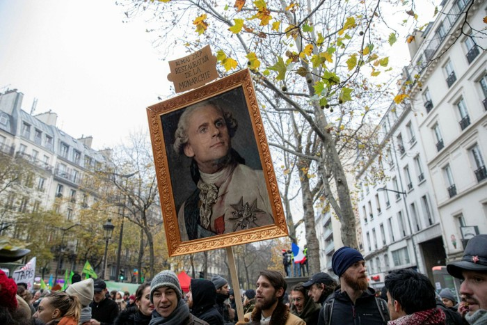 Protesters in Paris march against President Emmanuel Macron's proposed pension reforms. Many young people say they feel marginalised from mainstream politics dominated by older generations