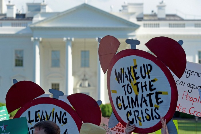 Protesters outside the White House in Washington, DC, after President Donald Trump announced the US would withdraw from the Paris climate change accord in 2017
