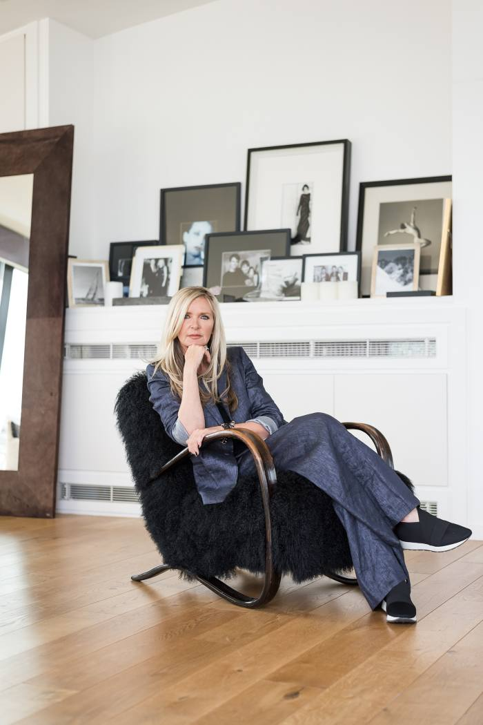 Amanda Wakeley on one of her pair of lambskin chairs by Jindrich Halabala