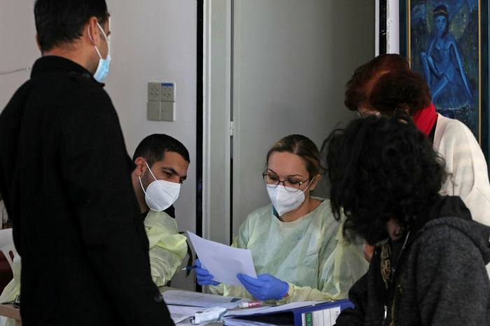 Health workers at a nursing home in Nicosia. Cyprus has asked Israel if it has any spare vaccine jabs
