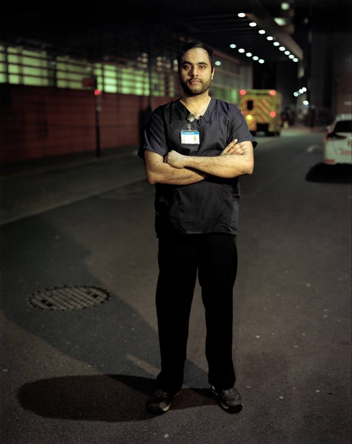 Dr Imran Ali outside the Royal London Hospital in Whitechapel, where he works as an anaesthetist. His father-in-law, a GP, died of Covid-19 in December, after a month in a coma
