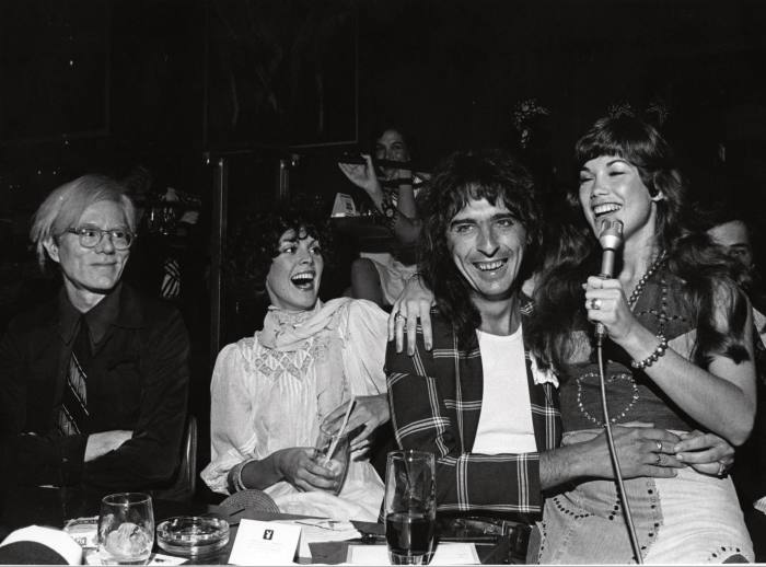 Cooper (second from right) with Andy Warhol (farleft) and model/singer Barbi Benton (far right) at the Playboy Club, New York, 1974