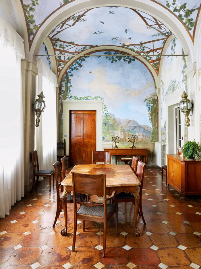 Hand-painted murals in the dining room at Villa Cetinale