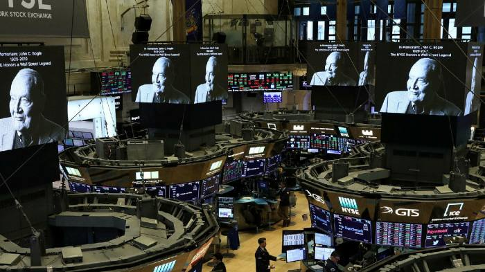 A tribute to Jack Bogle flashes on to screens at the New York Stock Exchange