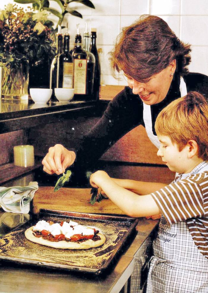 Clarke and her son Samuel cooking when he was a little boy