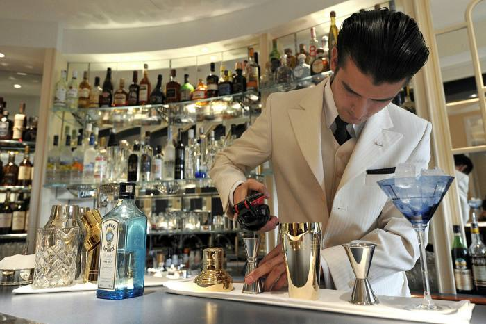 A cocktail waiter mixes drinks in the American Bar. The hotel has been losing money since the current owners purchased it in 2005