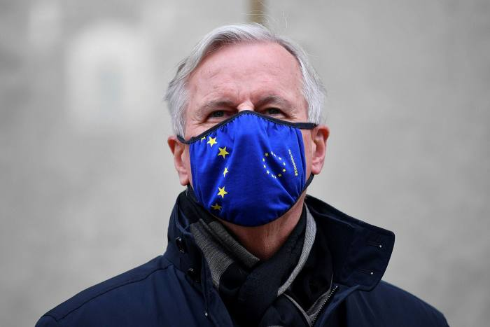 EU chief negotiator for Brexit, Michel Barnier, wears a mask with the EU flag during a break in talks